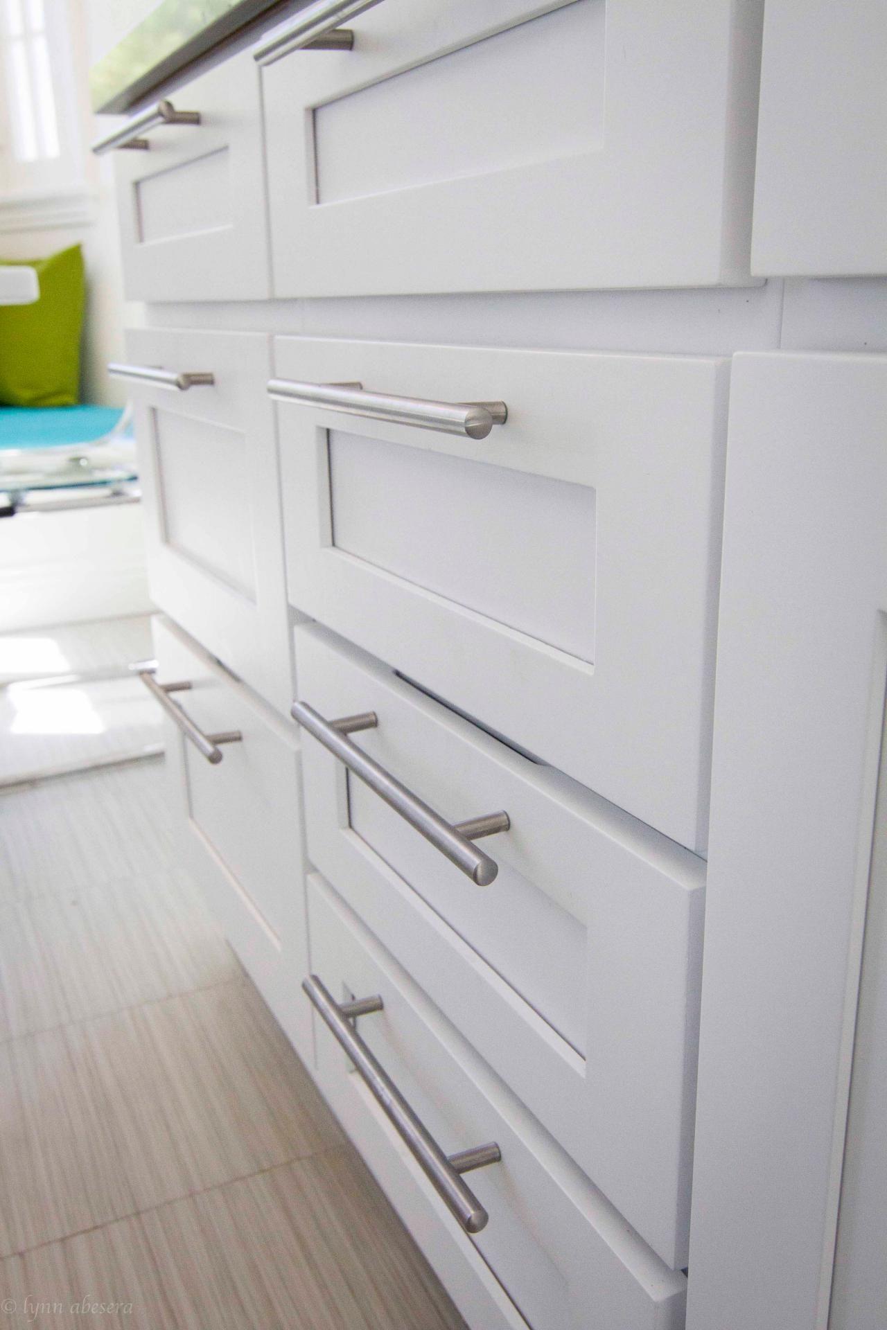 Contemporary Nickel Drawer Pulls In White Kitchen