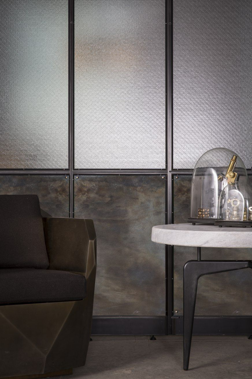 Wall divider frankford panel system by amuneal blackened steel patchwork and wire glass also