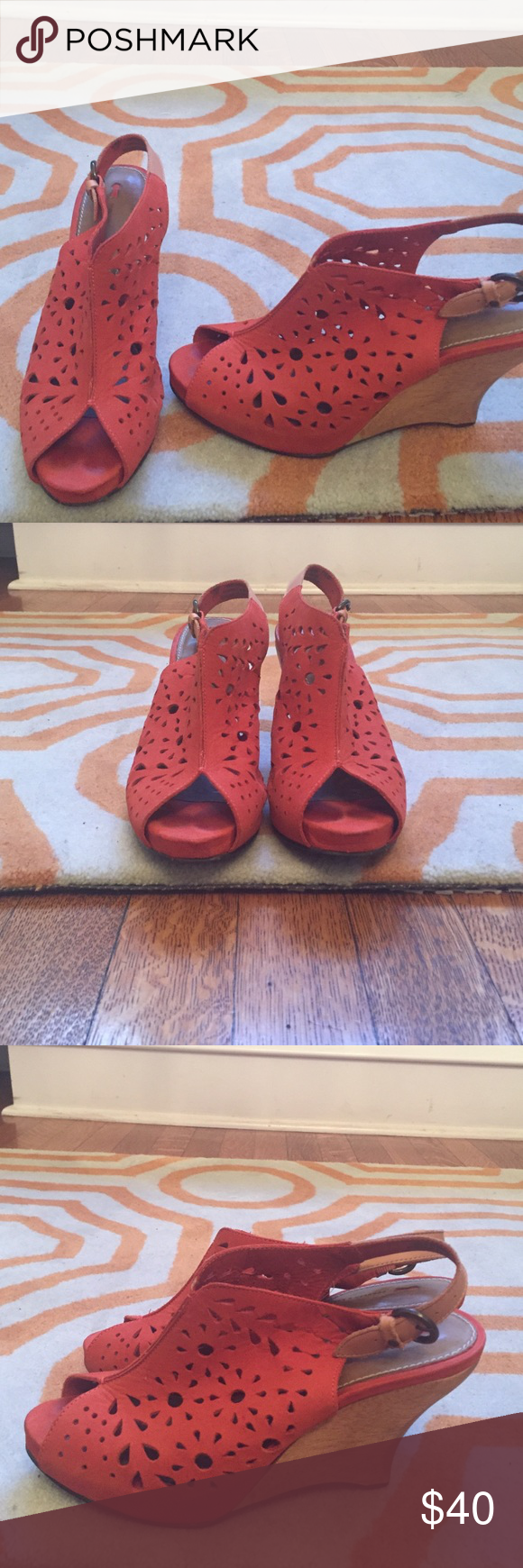 Anthropolgie wedges. Orange. Gorgeous Anthropologie wedges. Orange cutout leather. Wood wedge. One small scratch on heel. Size 7.5. Barely worn schuler and sons Shoes
