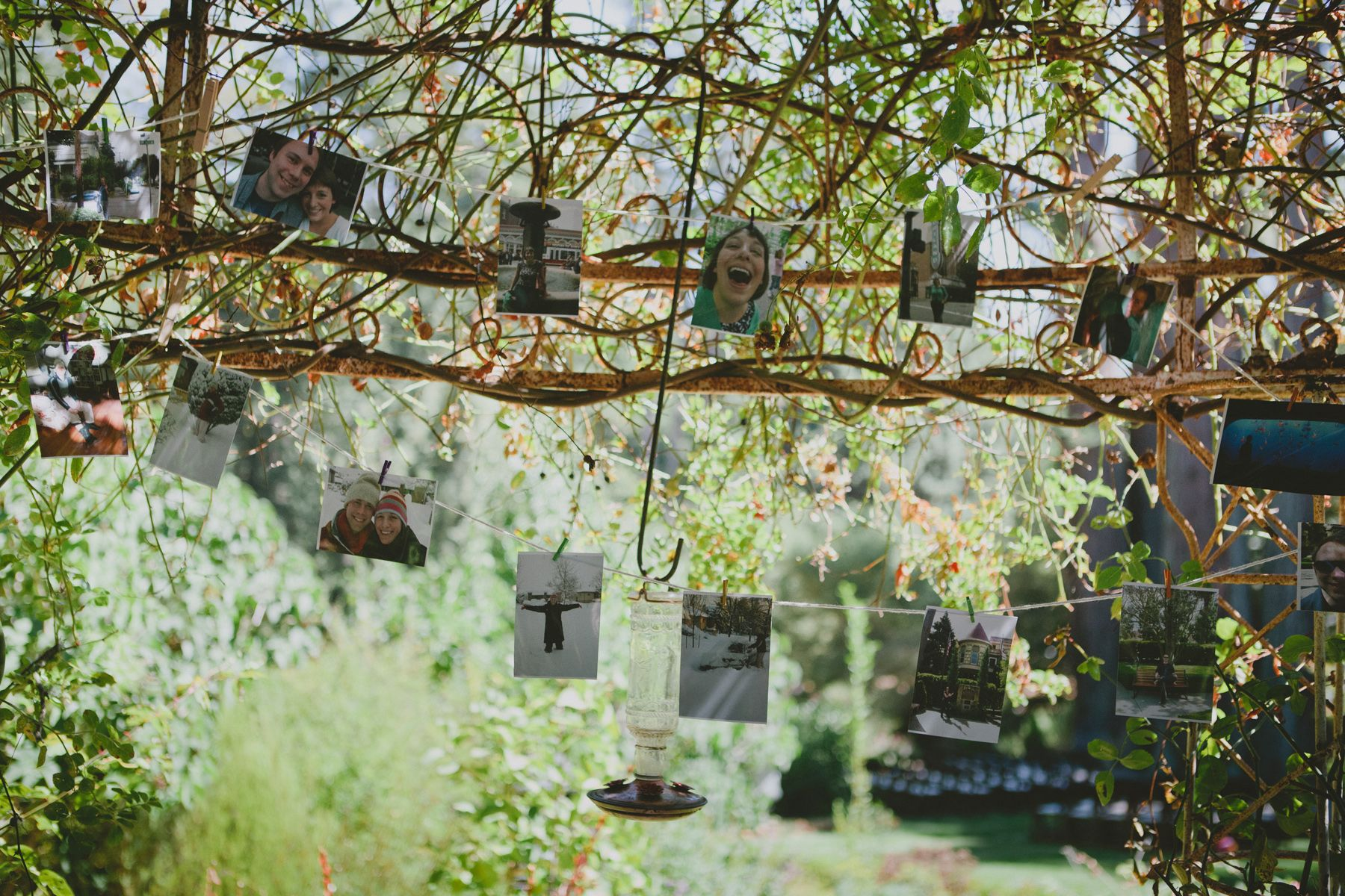 Wedding garland of the couple's photos strung on butcher's twine with clothespins