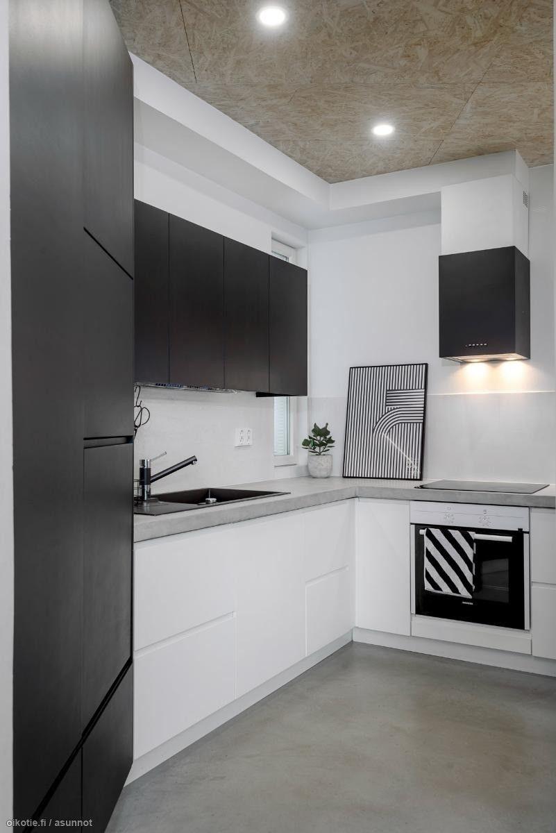 mustavalkoinen keittiö, betonitasot, kaunis liesituuletin