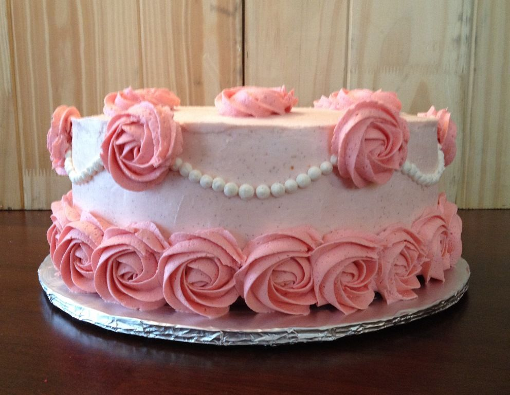 Girly pink roses cake with buttercream icing. Roses made ...