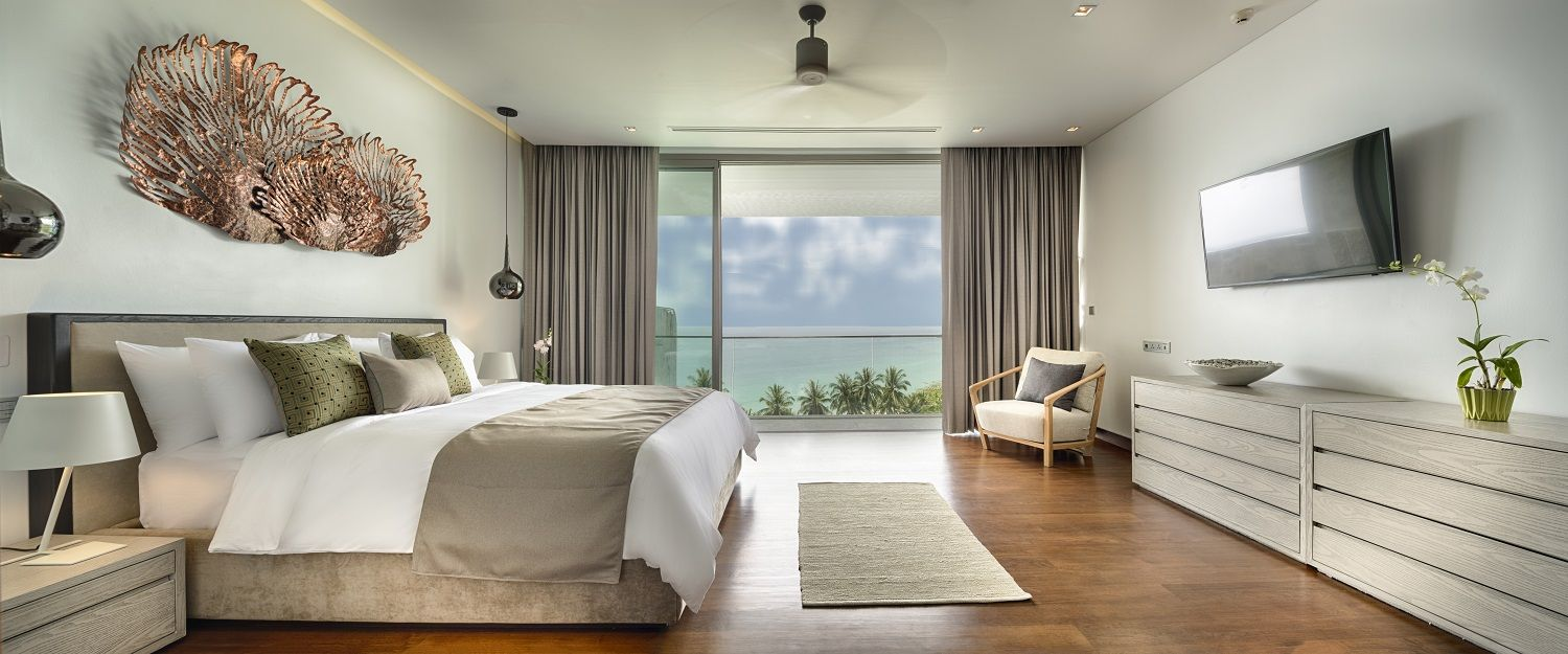 Upper floor master suites with spectacular sea views from floor-to-ceiling sliding windows and balcony