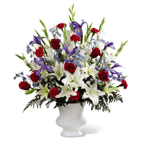 Red roses red carnations white gladiolus light blue for Red white blue flower arrangements