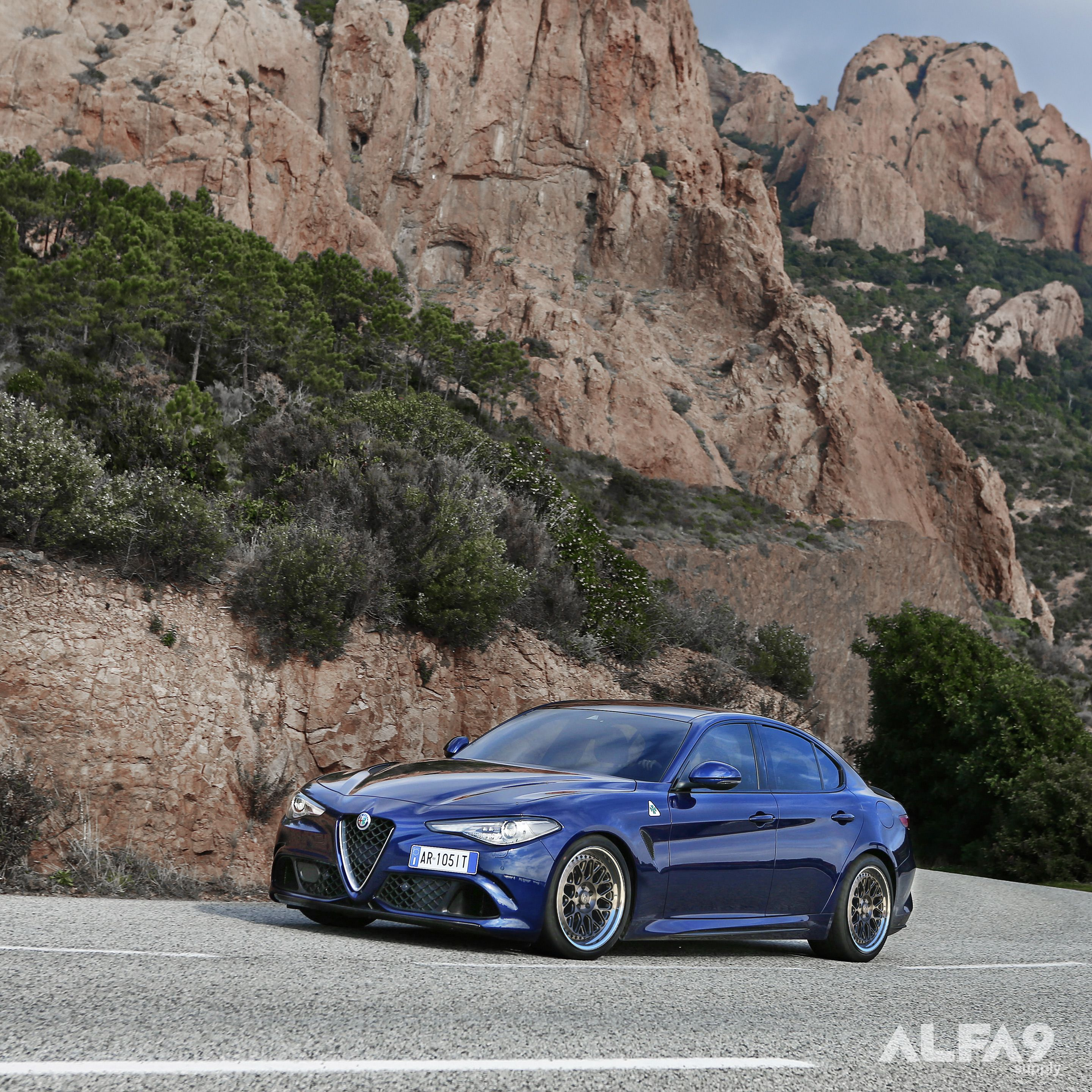 shop render with fifteen52 Forged Formula GT s on the Alfa