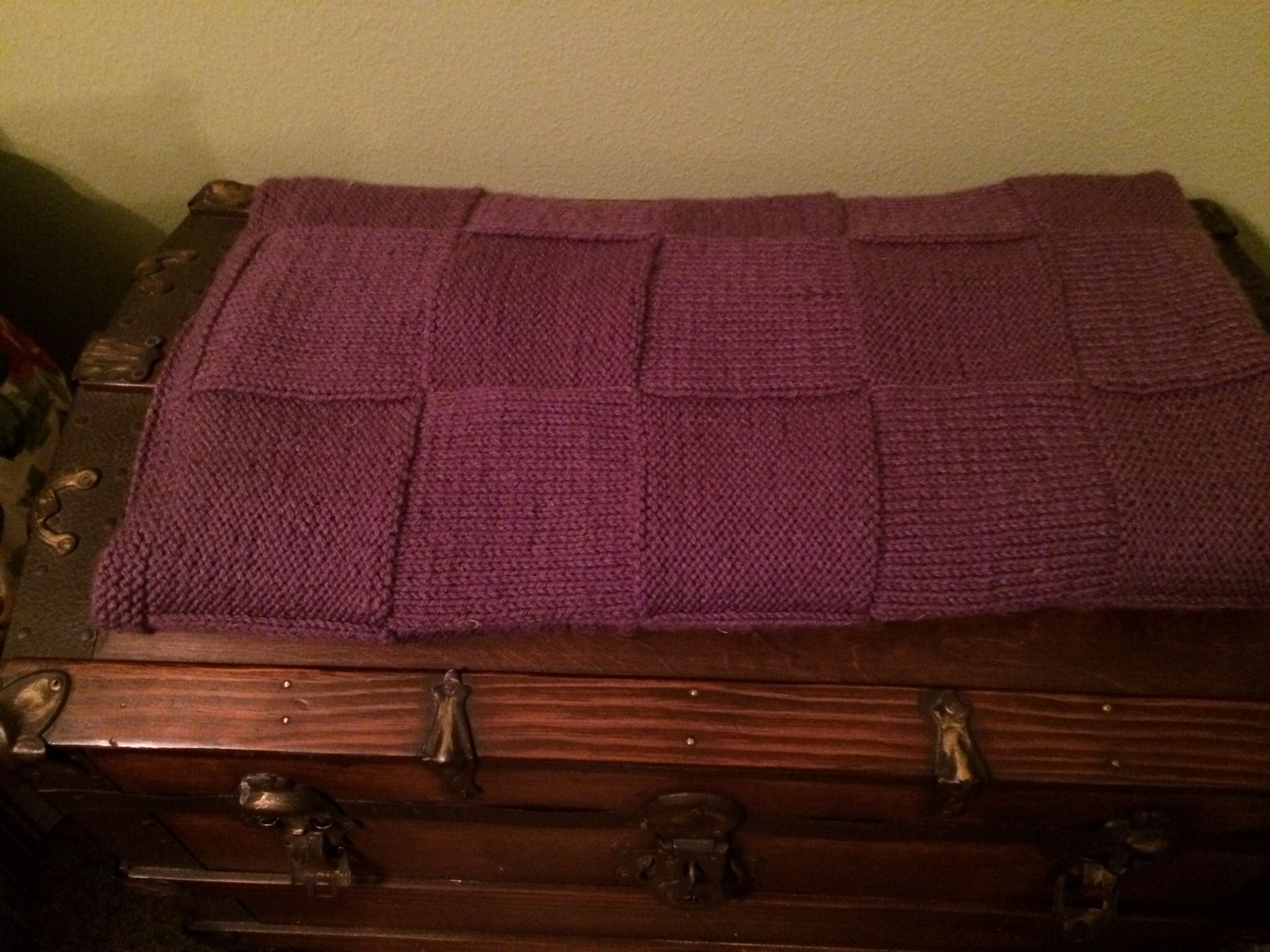 Knitting purple afghan gift to Mom.