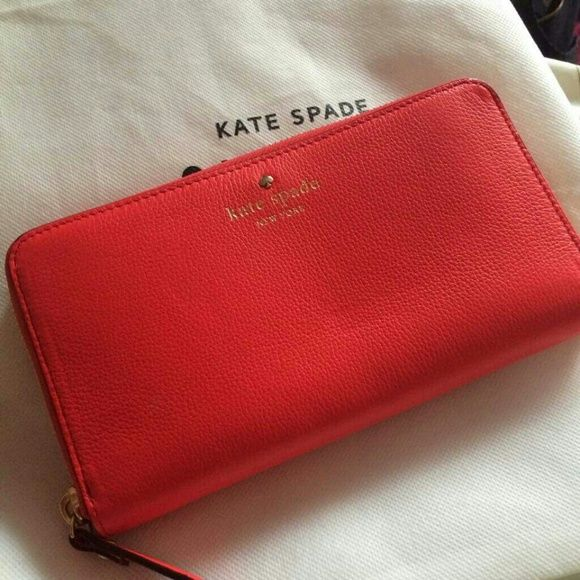"Kate Spade Cobble Hill Lacey wallet in Geranium Flawless brand new condition, with tags!  Pebbled leather. Gorgeous rich coral red color, the infamous ""Geranium"". Gold hardware.  ONLY willing to trade for Kendra Scott Danielle earrings, Deva druzy earrings, Deilly earrings, and Rayne necklaces! kate spade Bags Wallets"