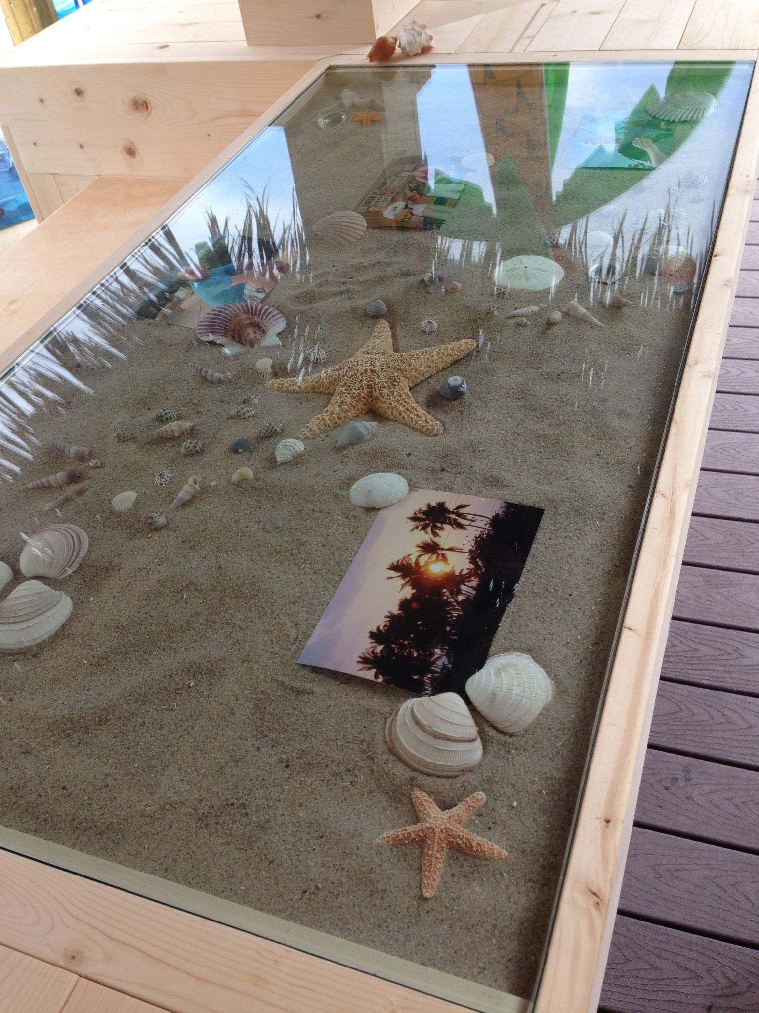personalized the tiki bar counter by adding a glass top with sand