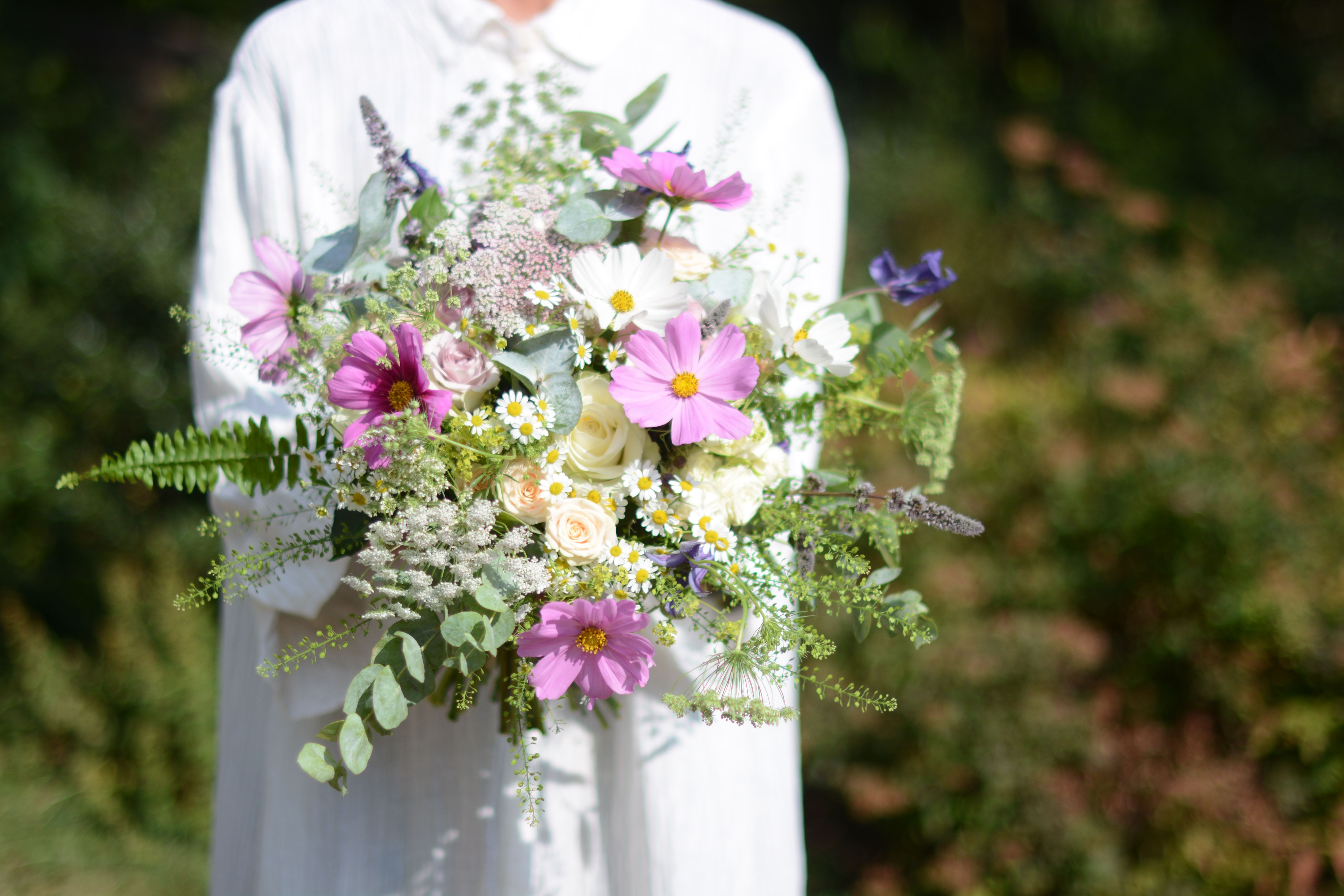b6858339 Rich textured tonal pink and cream summer flowers with mixed seasonal  greenery