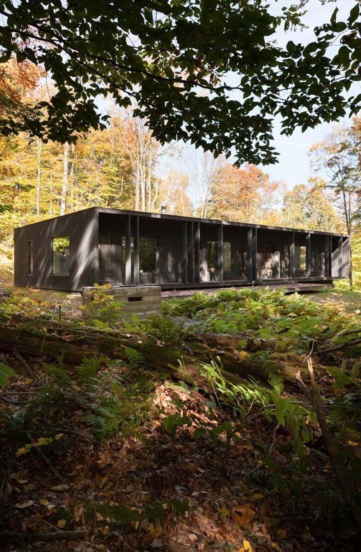 Modern cottage retreat in quebecus forested landscape modern