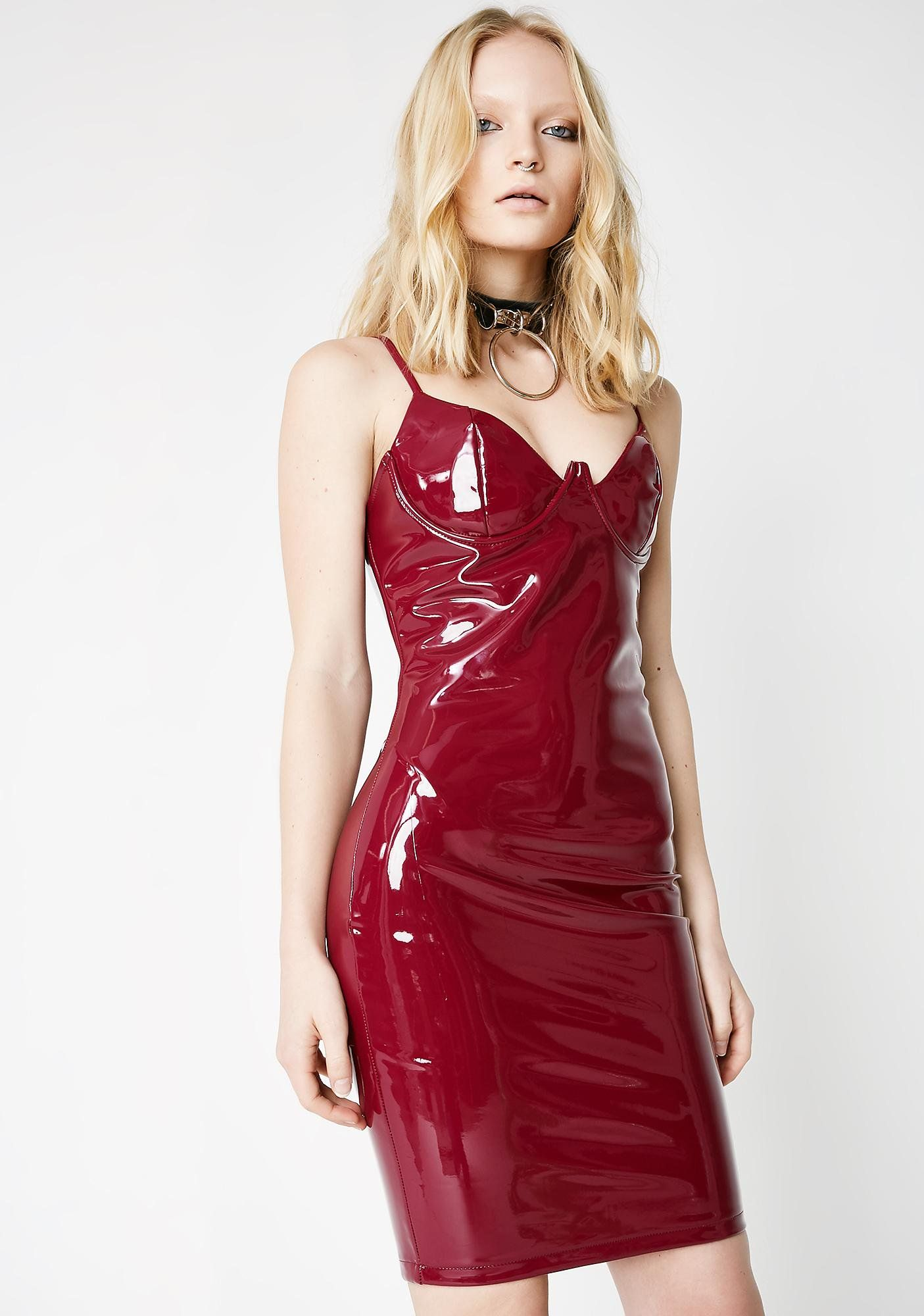 6b50a9c3c42 This berry red mini vinyl dress has a bodycon fit with adjustable spaghetti  straps and a zipper closure on the back.