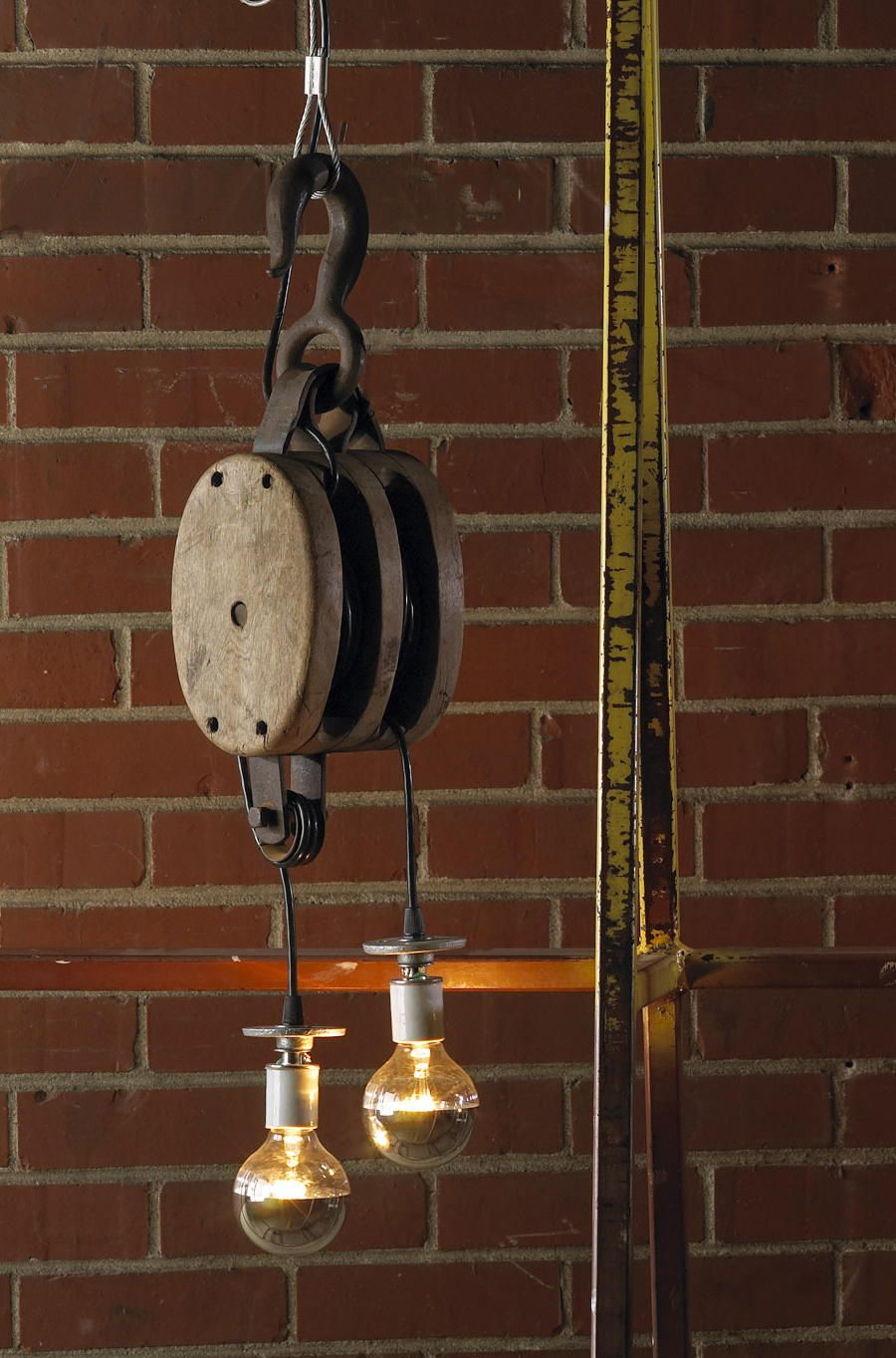 Decorating withvintage pulleys pulley light pulley and salvaged decor arubaitofo Choice Image