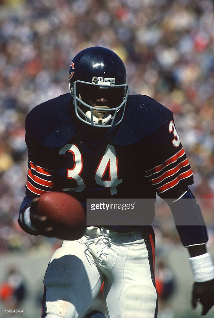 Running Back Walter Payton Of The Chicago Bears Carries The Ball Chicago Bears Football Walter Payton Nfl Football Players