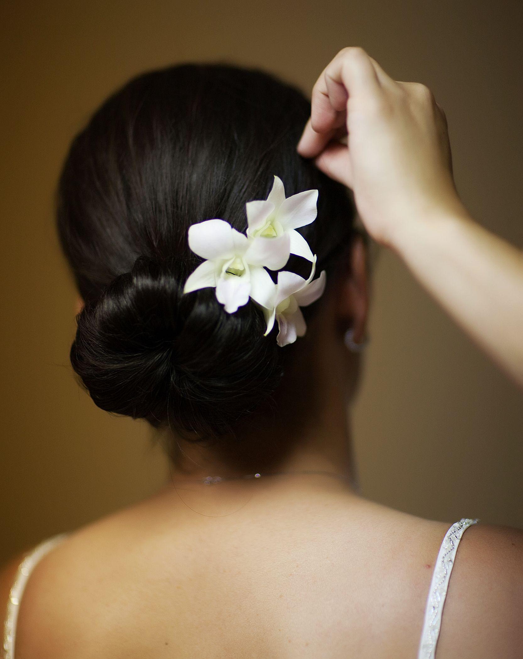 white orchids in wedding hair style. www.lorasweddingflowers