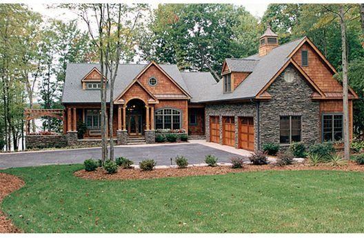 there is no plan to this link but I like the exterior with the contrasting siding to the stone and the three car garage L-shape layout.