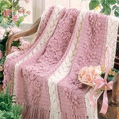 "Floral Cascade Afghan Crochet ePattern - Number of Designs: 1 afghanApproximate Design Size: 54"" x 67""Designer: Rena V. StevensOriginal Publication: Crochet With Heart magazine, June 1996 issueSkill Level: Experienced †Description: Cascading flowers take center stage on this dreamy afghan. The blossoms on the middle panel are bordered by alternating panels of leaves and berries. We used post and popcorn stitches to create the three-dimensional motifs, and reverse single crochets to join the…"