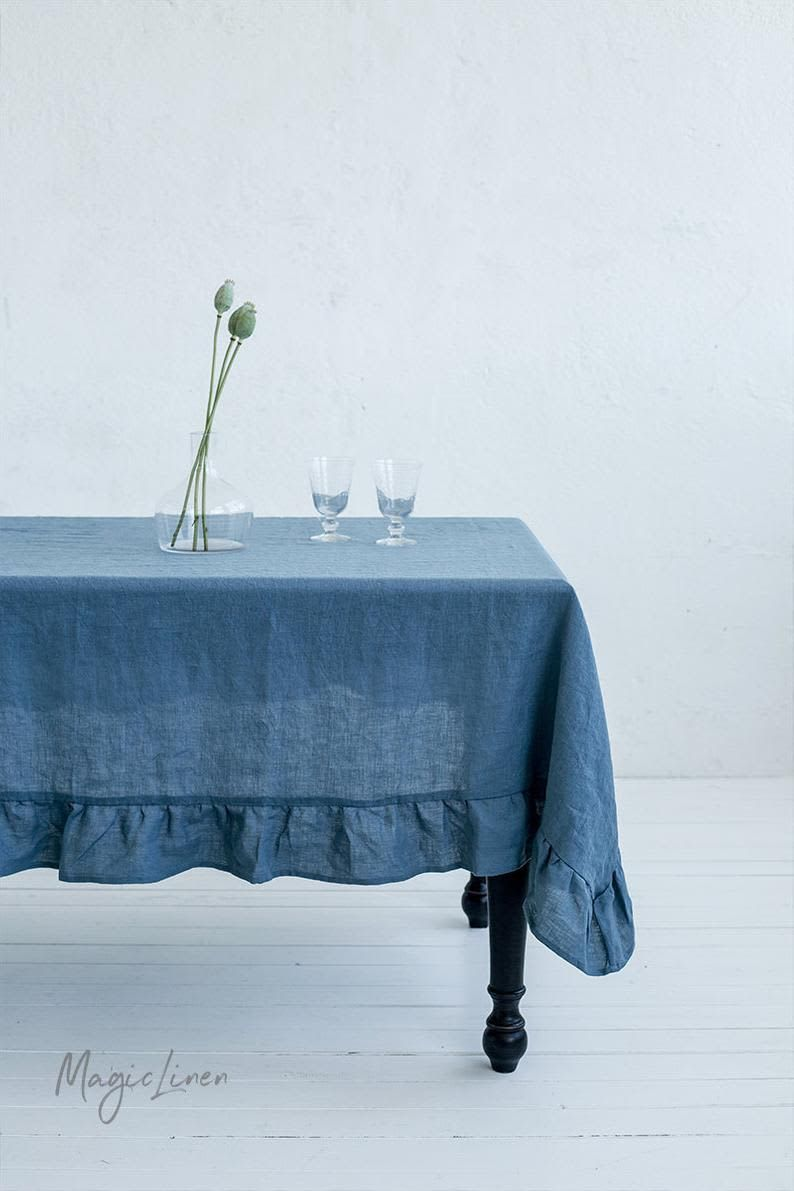 7 Summer Tablecloths That Are Stylish Not Stuffy With Images Table Linens Ruffle Linen Linen Tablecloth