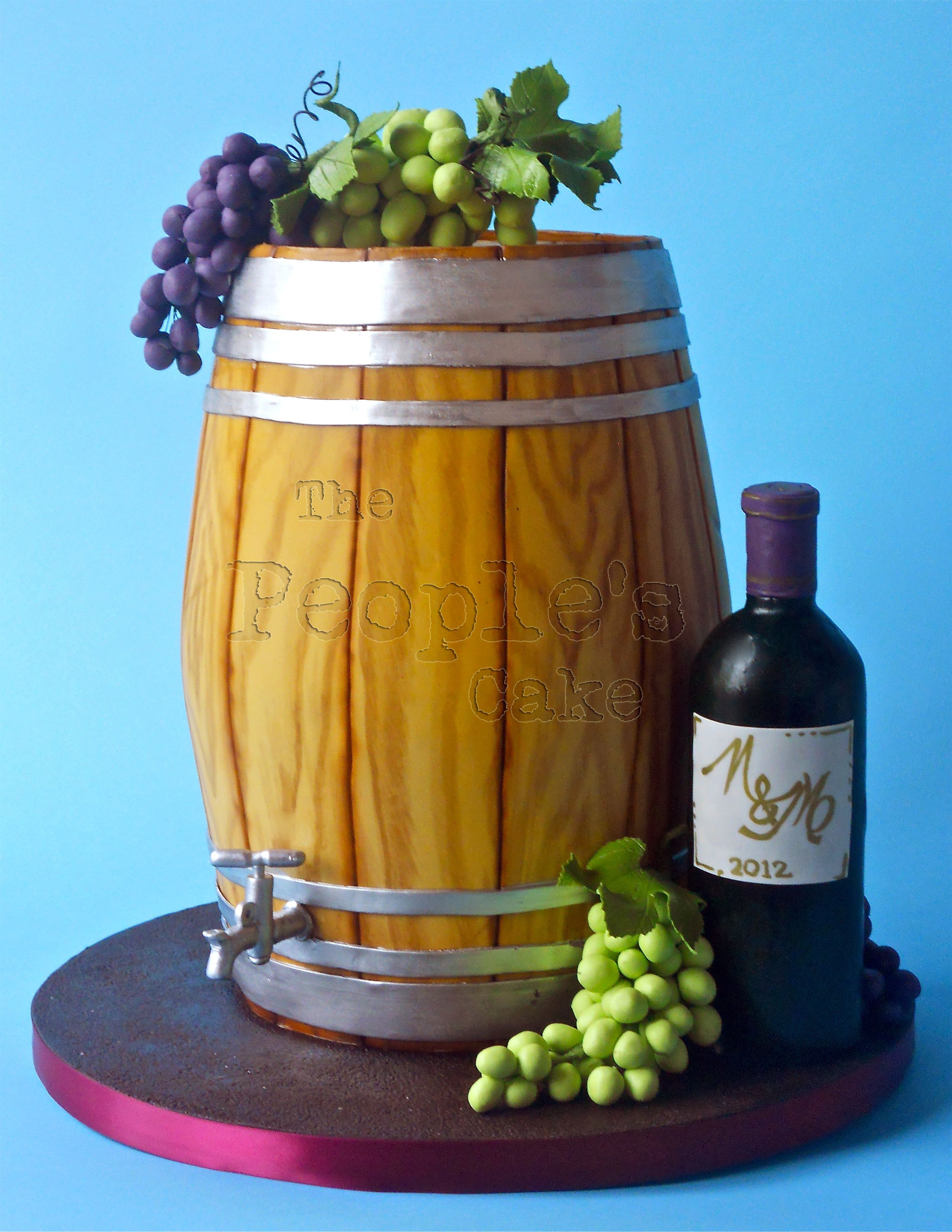 Wine Barrel Cake With Chocolate Grapes And Bottle