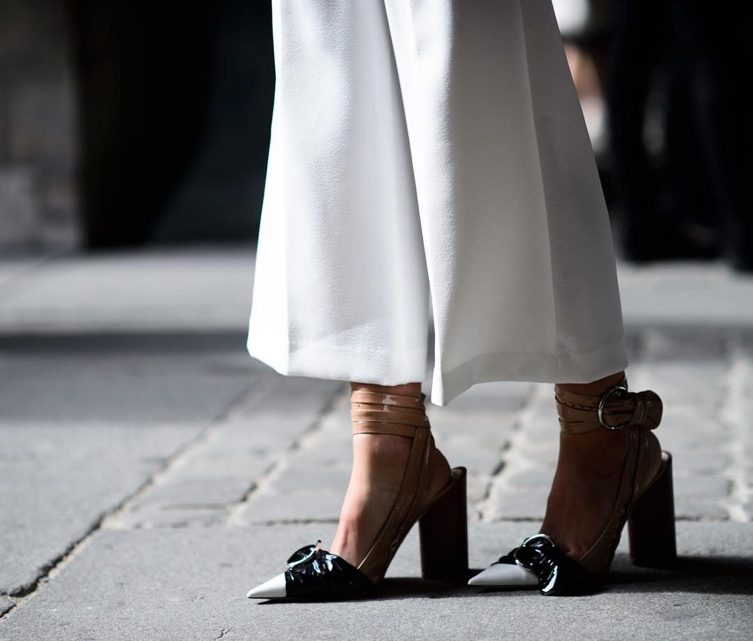 """Move over @Gucci slipper. The """"It"""" shoe at Paris Fashion Week was @Dior's double buckle pump. See 5 ways to style this season's favorite shoe on wmag.com. Photo by @le21eme. #PFW by wmag"""