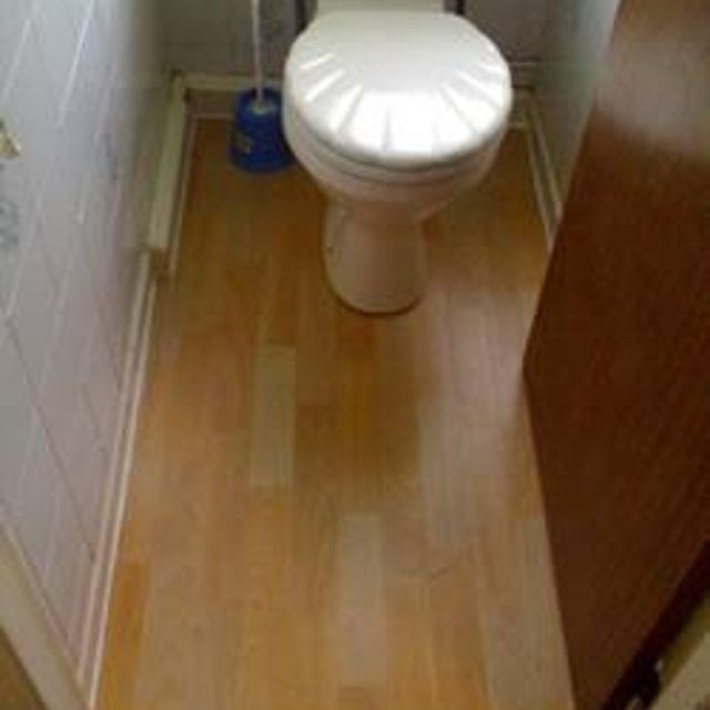 How To Lay Laminate Flooring Hunker Laying Laminate Flooring Installing Laminate Flooring Laminate Flooring Bathroom