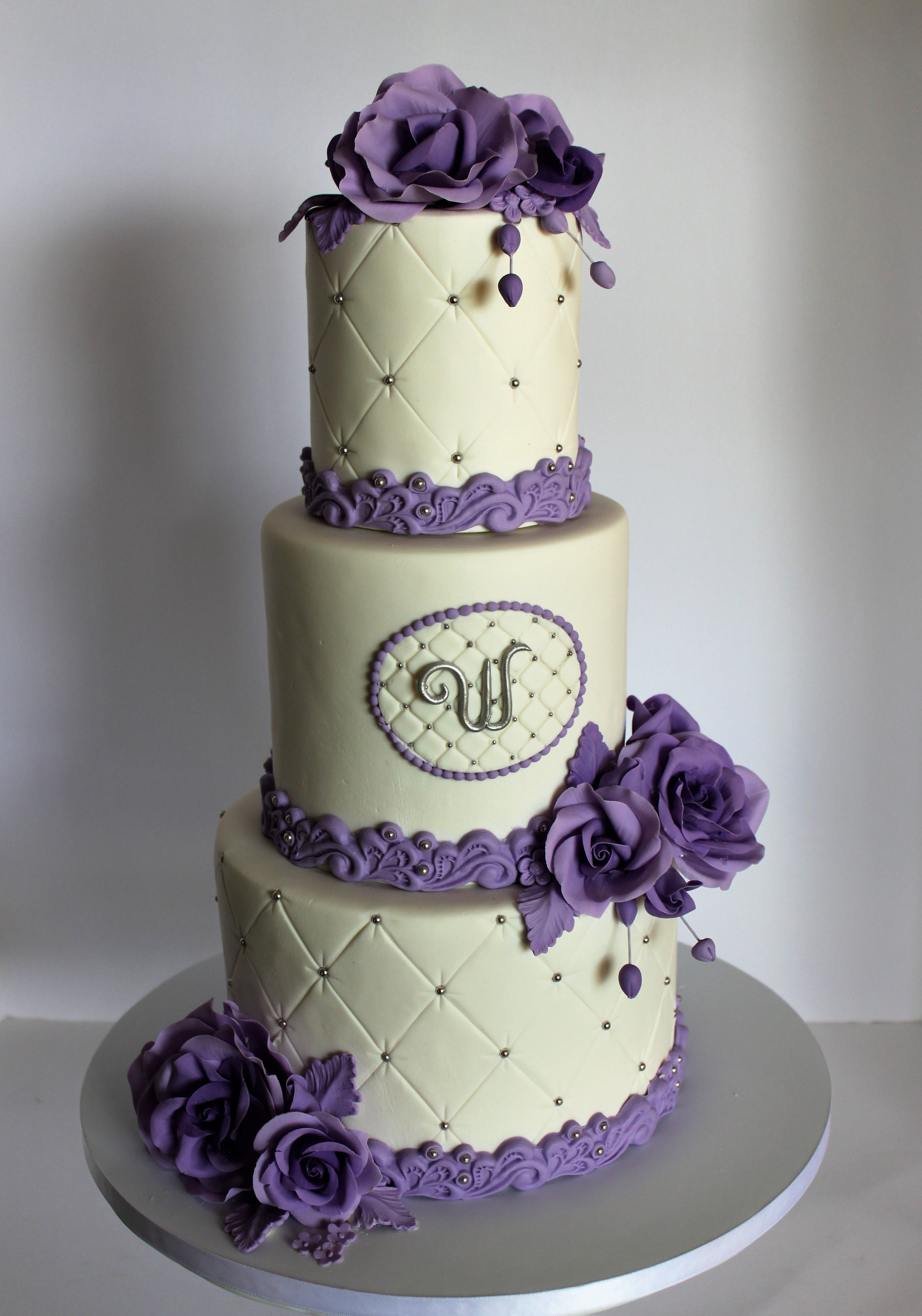 Wedding cake with purple roses and quilted pattern