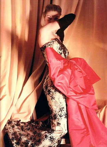 Jean Patchett in Balenciaga's black lace dress with hot pink satin bow, 1950