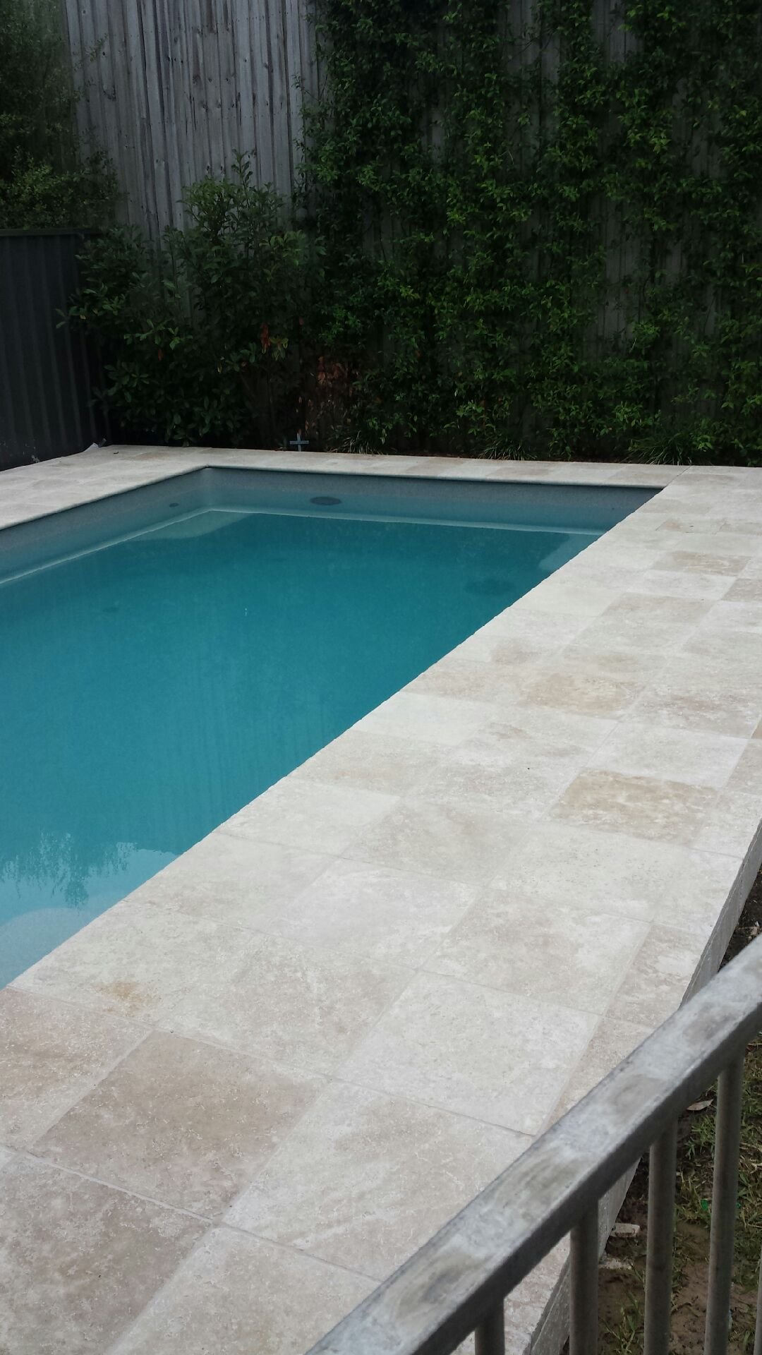 Adamstown pool surround 2014 almond travertine pavers for Swimming pool surrounds design