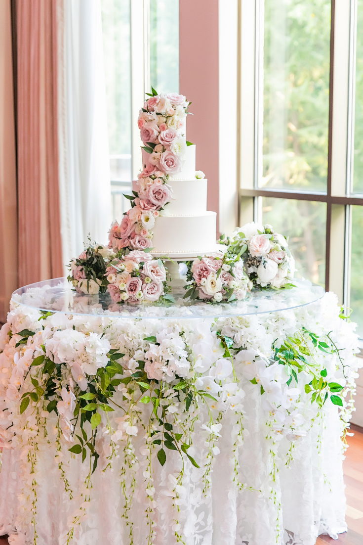 Elegant Wedding Cake Display With Orchids Wisteria And Greenery Draping Underneath Designe Wedding Cake Display Wedding Cake Display Table Wedding Cake Table