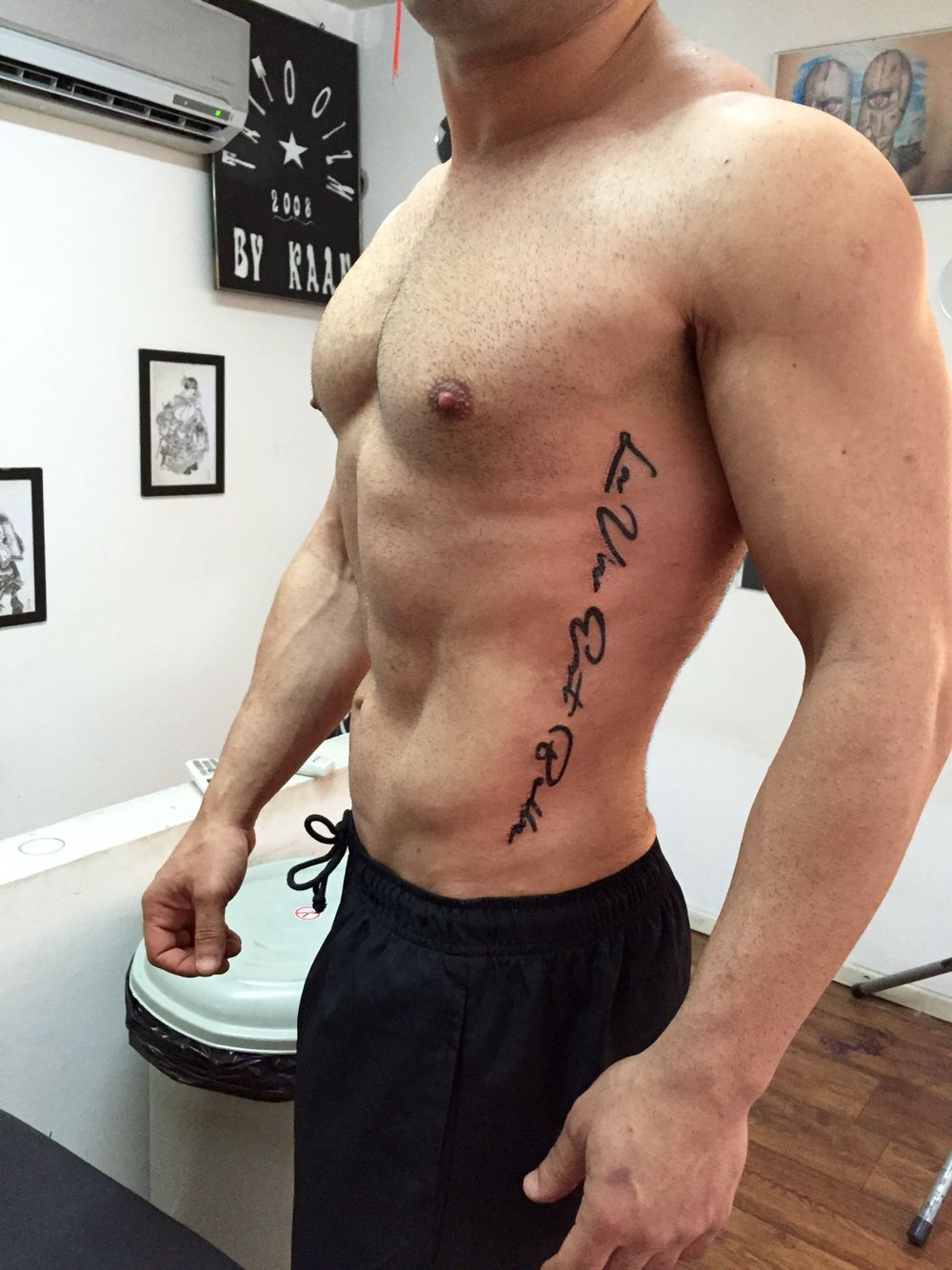Vertical Spine Font Tattoos Men: Man Tattoo On The Rib Quote