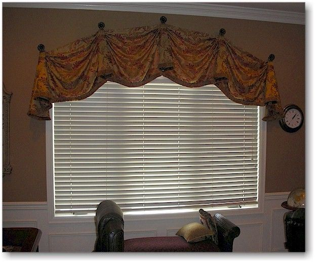 Modified Kingston Valance On A Top Curved Window Supported With Iron Tiebacks