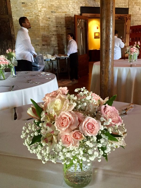 Centerpieces featuring pink roses adorn each table at Sara Rose\u0027s