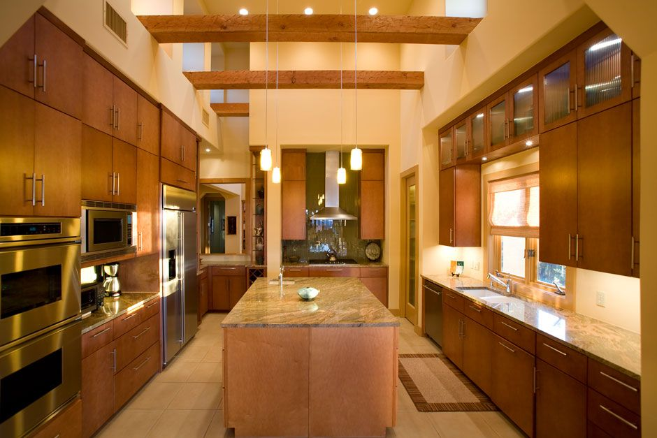 Maple slab cabinet doors in this contemporary kitchen