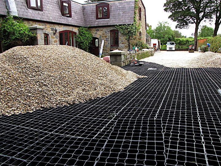 Gravel driveways and driveway reinforcement grids