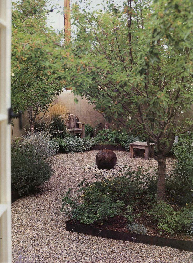 Photo of Gravel yard with steel edge Trees with shade-loving plants
