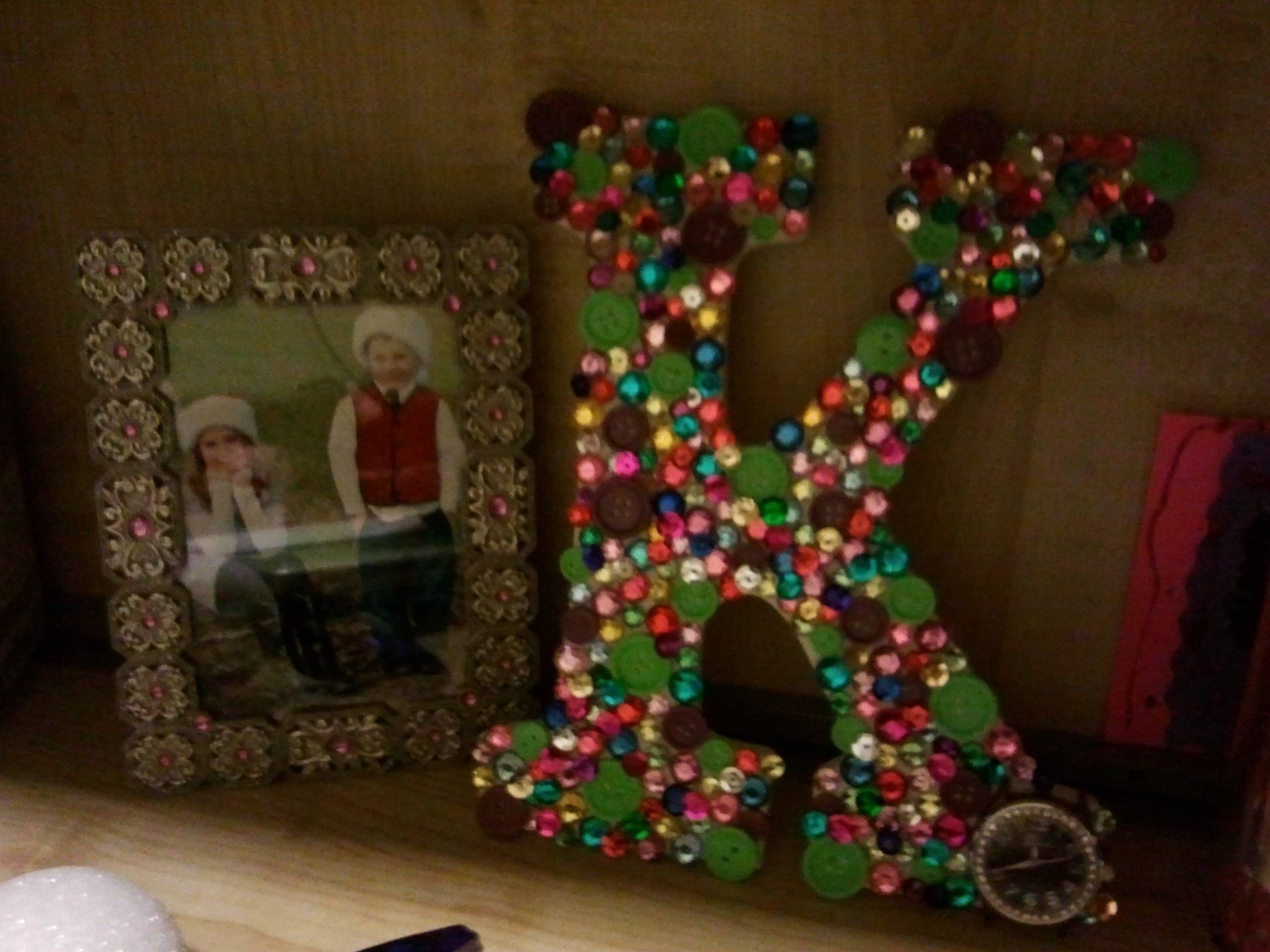 I took a plain letter from michaels and hot glued