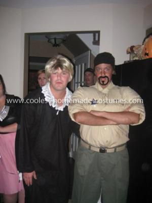 Homemade Judge Judy and Security Guard Couple Costume: My husband and I LOVE Judge Judy, we watch it every night during dinner (which our friends find halarious), so we decided to dress up like Jude Judy and