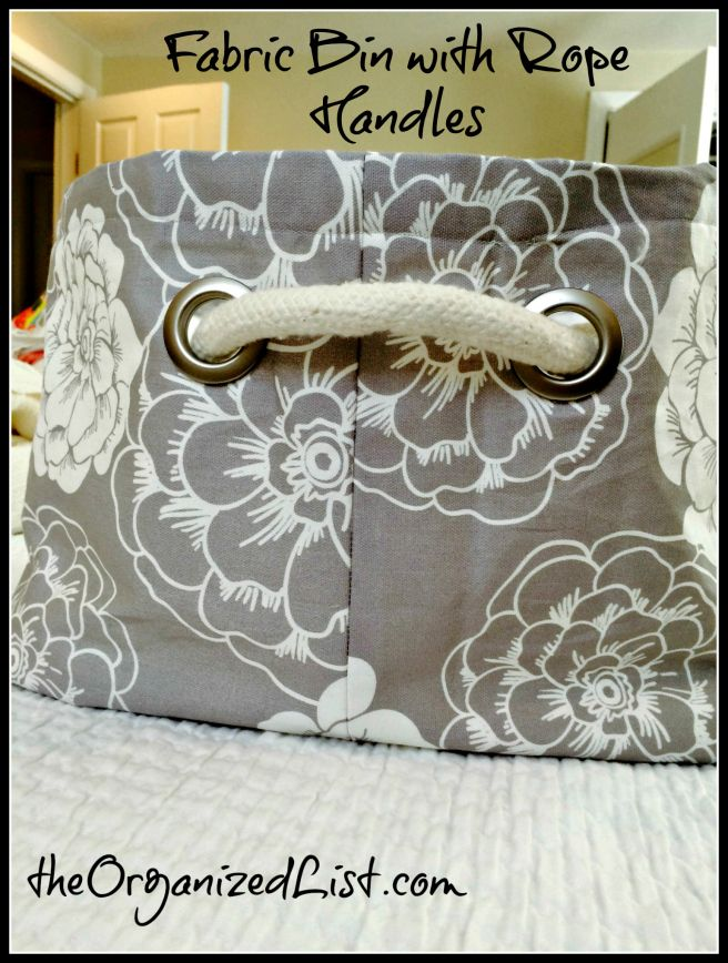 Make your own stylish fabric bin with cotton lining and rope handles using curtain grommets.