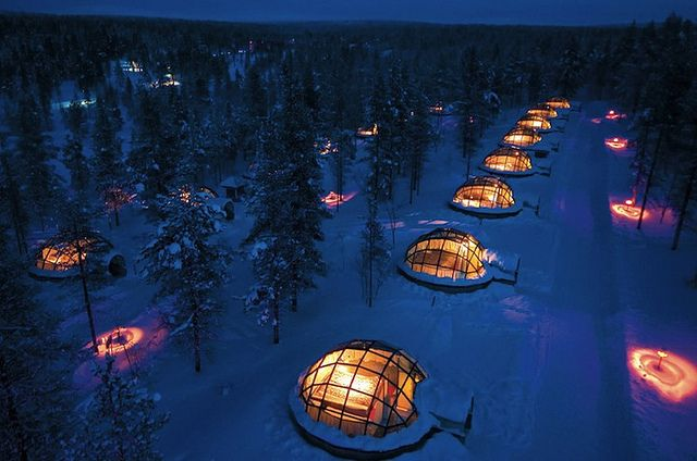 Watching the northern lights from glass igloos in Kakslauttanen, Finland