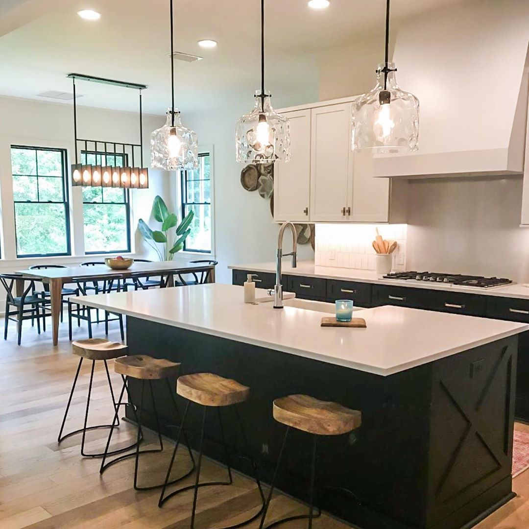 Modern Farmhouse With Two Toned Kitchen Cabinets Matte Black Clear Glass Island Pendants Industrial Modern Kitchen Kitchen Remodel Farmhouse Kitchen Cabinets