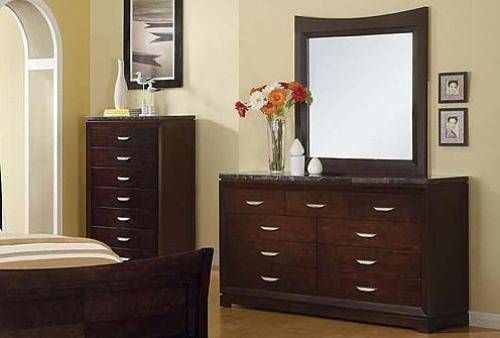 Black bedroom furniture finished with beautiful marble tops are in ...