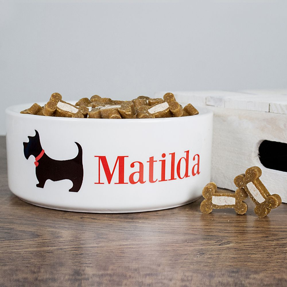 Deep ceramic dog bowl with adorable Scottie Dog. Can be personalised with your dog's name.
