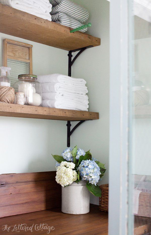 Laundry room rustic wood shelves old door countertop for Laundry room shelving