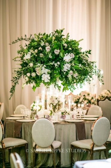 Tall Large Centerpiece Of Greenery With White Florals Surrounded By Small Arrangements And Candles Fl Greenery Centerpiece Large Centerpiece Tall Centerpieces