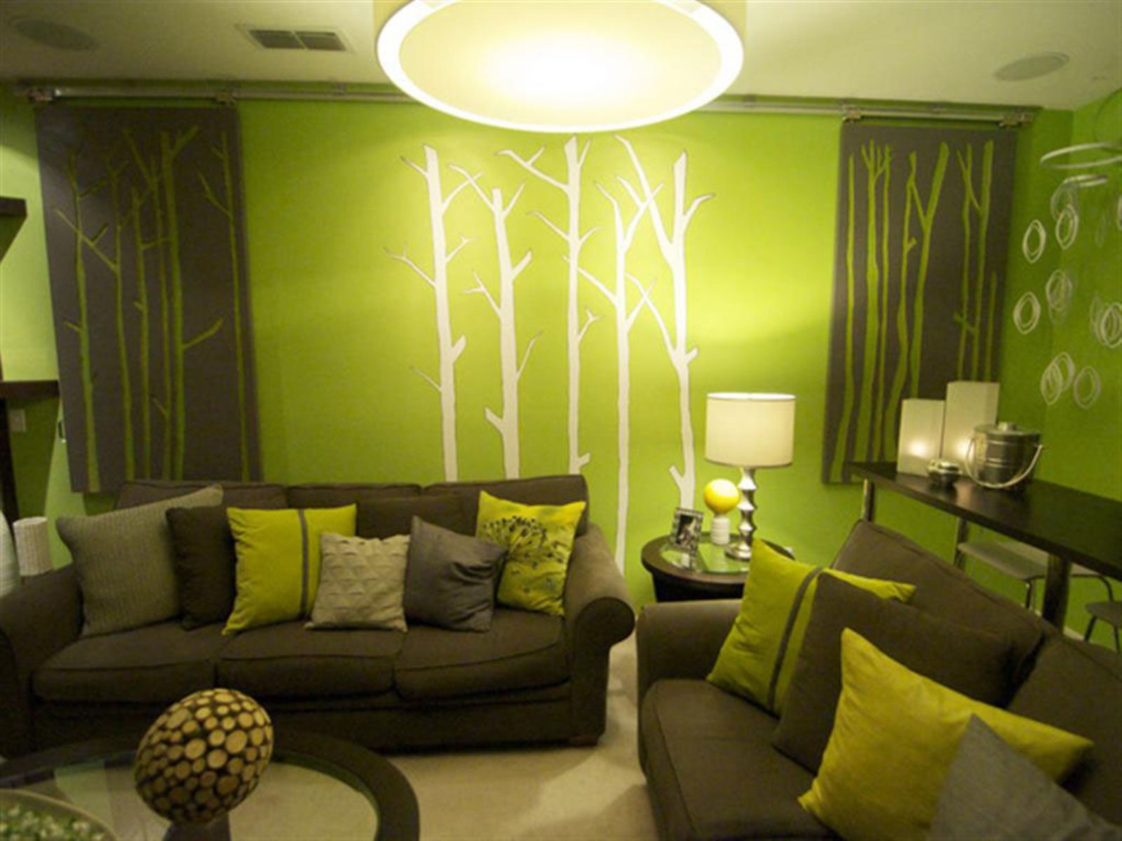 Beautiful Green Wall Decors With White Trees Decals And Green Sofas ...