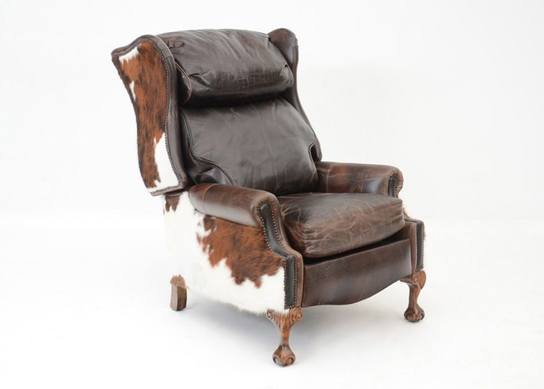 A large in size, handsome, Southwestern cowhide and leather reclining wingback chair with embossed alligator print to the headrest and footrest, distressed leather to the seat, cowhide to the sides...