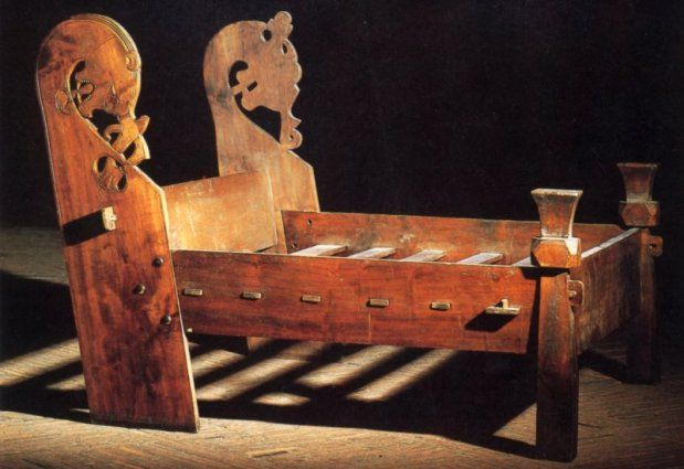 Three whole bedsteads and several fragments were found in the Oseberg burial. The large bedstead was found towards the stem of the ship. It was made of beech, and was 2.20 m long and 1.90 m wide. At  the headboard, the bedstead is capped with carved animal heads.The carved ornaments have been painted, and other decorations have been painted on the flat surfaces.