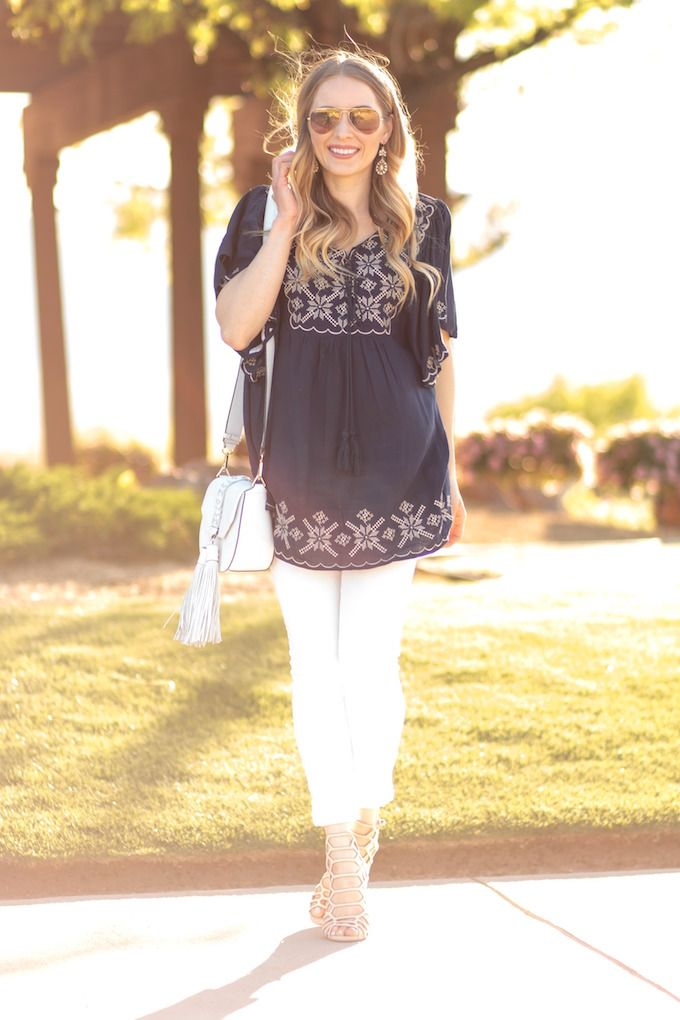 golden hour Glamour-Zine wearing embroidered top white skinny jeans and steve madden caged sandals