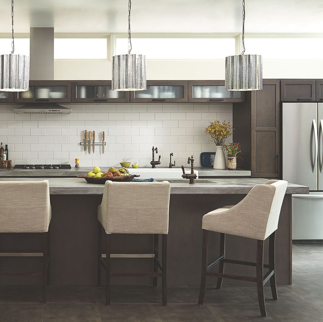 Contrast Dark Cabinets With Stainless Steel Appliances And Lightly Colored Bar Stools For A Dynamic Kitchens And Bedrooms Kitchen Inspirations Kitchen Remodel