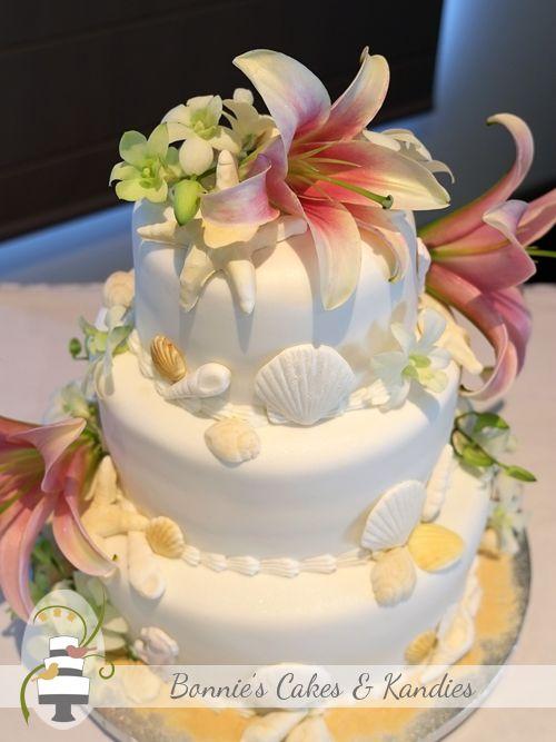Beach Theme Wedding Cakes And Fresh Flowers For A Beach