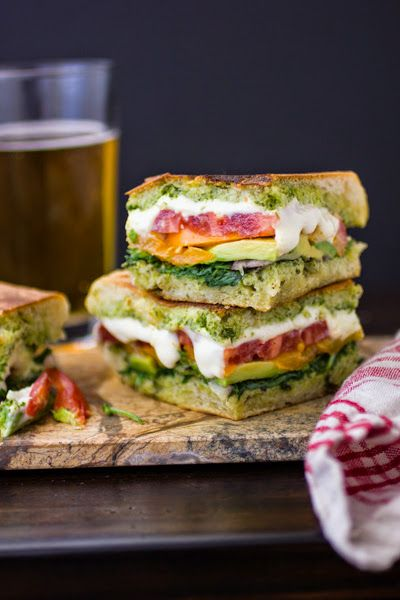 Come tomato season, our favorite quick lunch is an open-face sandwich made from a slice of good bread toasted with melty cheese and topped with our favorite pesto, avocado, and fresh tomatoes.